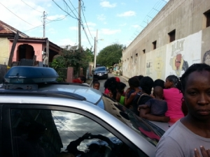 Residents gather near the scene of the crime - Ricardo Makyn/Staff Photographer