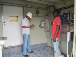 Distribution Engineer, Ryan McPherson inspects premises of a potential net billing customer.